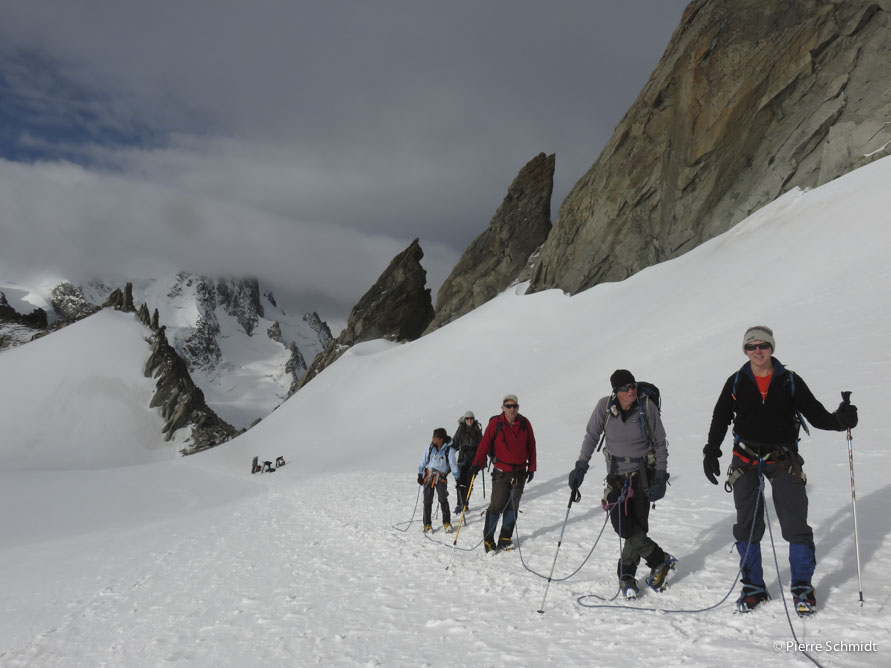 Walking on Trient glacier, heading to Aiguille du Tour on Mont Blanc course